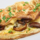 Fresh omelet filled with sauteed mushrooms and cheese